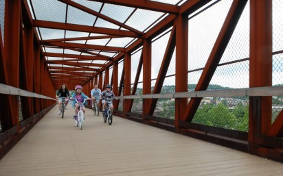 Bikers on the Great Allegheny Passage bike trail after passing under the new viaduct that has been installed, 2005 (VWH Campbell)