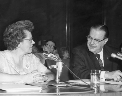 Senator Scott talking with Wilma Scott Heide, Chairman of the Board for NOW, before the Judiciary Committee where she testified in support of the Equal Rights Amendment, 1970 (Credit Unknown)