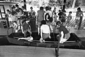 Kids and adults ride on the small boats through the darkness on the Old Mill ride. The ride lasts about 5 minutes, June 1984. (Mark Rightmire/The Pittsburgh Press)