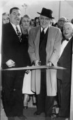 Store opening 1954:Lawrence, center, with Joe Goldstein, right. (Sun-Telegraph photo)