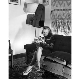 Ann Bradford of Castle Shannon reads during a dimout in 1942. (Photo credit: Unknown)