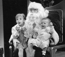 Nicole Barr, 3, said she wanted a baby want to walk. Bethany, 1, apparently wanted to get off Santa's lap (Dec. 10, 1991).
