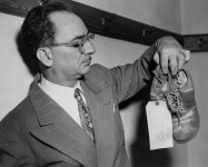 Assistant district attorney displayed shoes of the victim. (Pittsburgh Press photo)