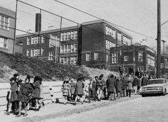 Students walk down Hazelwood Avenue. (Albert Herrmann Jr./The Post-Gazette)