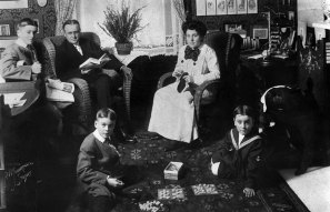 Rinehart with husband Stanley and their three sons in the family's Beech Street home in 1909. (Photo credit: Unknown)