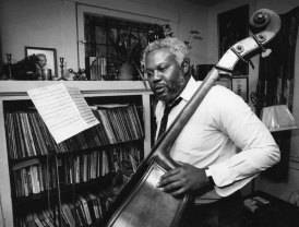 Milliones relaxed by playing a bass at his home. (Jim Fetters/The Pittsburgh Press)