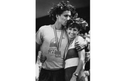 Ken Martin gives his wife, Lisa, a kiss on the head after the race. They were the first husband and wife to win their respective categories at a marathon. (Pittsburgh Press photo)