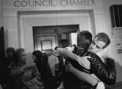 Oct. 11, 1988: Mike McFadden (facing camera) and Terry Macko embrace outside Pittsburgh City Council chamber after members defeated a gay rights bill. (Credit: John Beale/Post-Gazette)