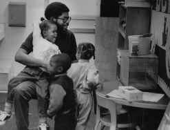 Gordon William, an assistant teacher in Hill House Center's day can center, works with youngsters in 1989. (Tony Tye/Post-Gazette)