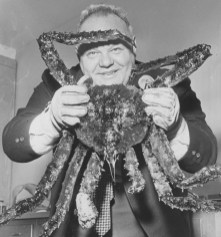 November 24, 1967: After some coaxing, Roger Conklin gets grip on Alaskan crab. (Donald Stetzer/Post-Gazette)