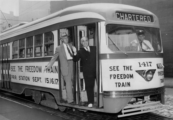 A streetcar promotes the arrival of the Freedom Train in Pittsburgh in 1948. At left is Thomas Fitzgerald, trustee of Pittsburgh Railways. At right is Councilman A.L. Walk. (Credit: unknown)