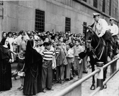 Mounted police keep order as people line up outside the U.S. District Courthouse and Post Office to see historic American documents aboard the Freedom Train in September 1948. (Credit: unknown)