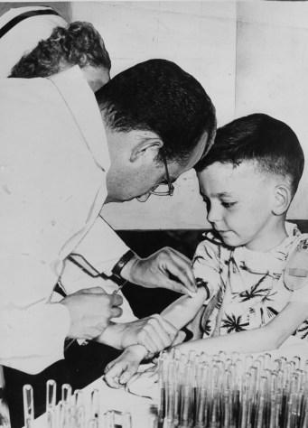 Dr. Jonas E. Salk and Arthur Donahoo of Washington, Pa. (Credit: The Pittsburgh Press)