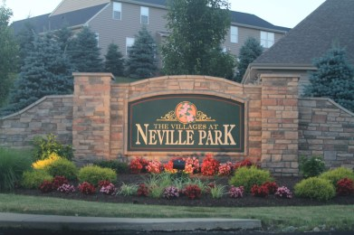 2014: A sign for The Villages at Neville Park exists at the former entrance to Woodville. (Ethan Magoc/Post-Gazette)
