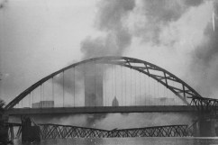 May 29, 1978: Demolition of the bridge with the Pittsburgh skyline in the background. (Morris Berman/Post-Gazette)