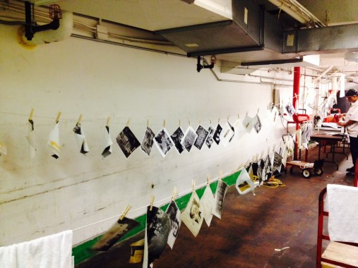 Two clothes lines were hung to keep photos from sticking together. (Mila Sanina/Post-Gazette)