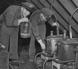 Nov. 11, 1949: Gibsonia patrolman James. W. Homison and Chief Ed Sherwood raided a four-man, 13-still bootleg factory. (The Pittsburgh Press)
