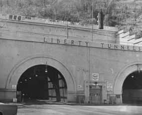 April 23, 1972: The Pittsburgh Press in its published photo cutline remarked about the effort it took to climb down the hill to reach the top of the Liberty Tunnel and paint a fraternity affiliation.
