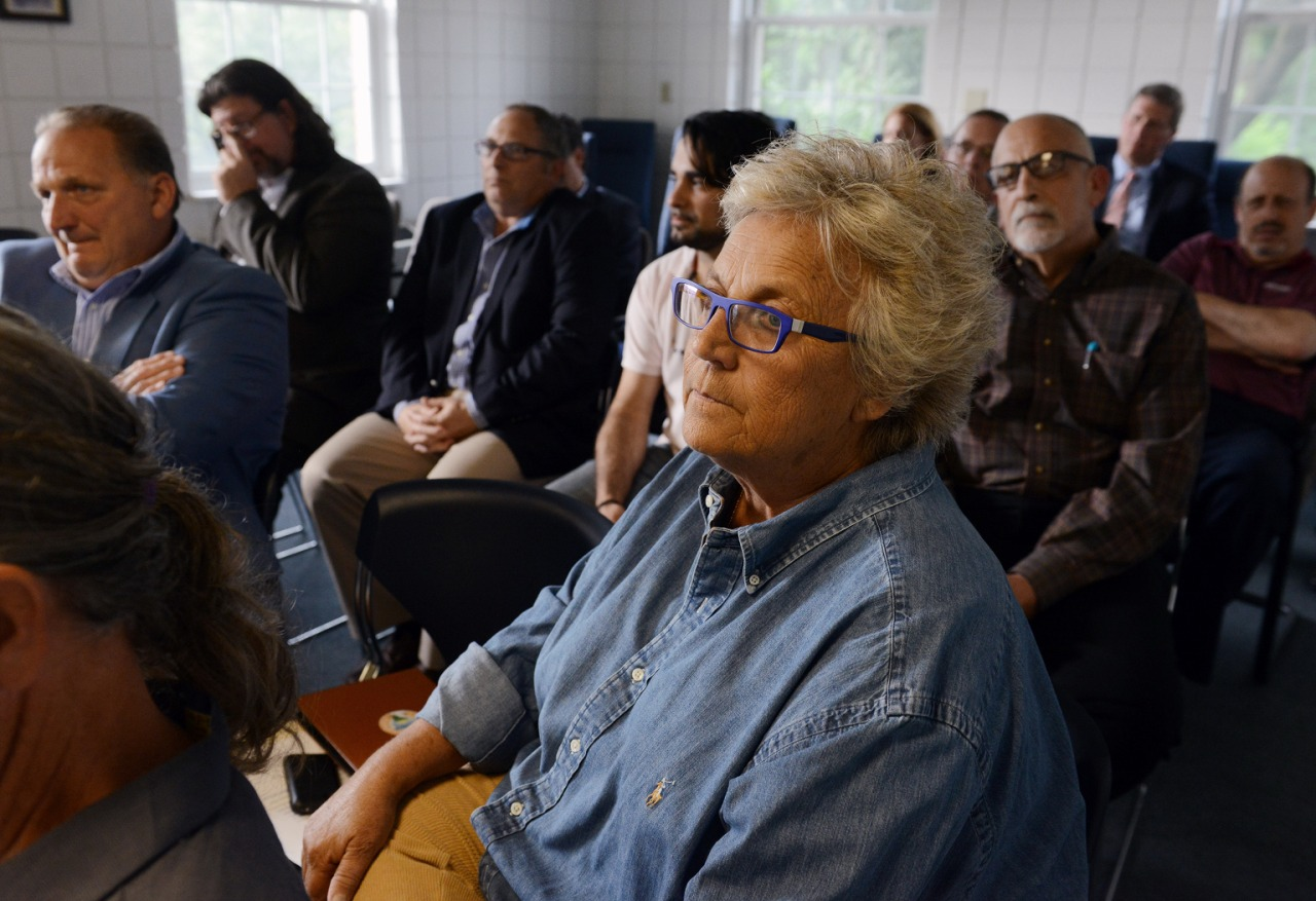 Pam Cohen, owner of the diner, listens at a public hearing at the Clack Health Center in Lawrenceville. (Rebecca Droke/Post-Gazette)