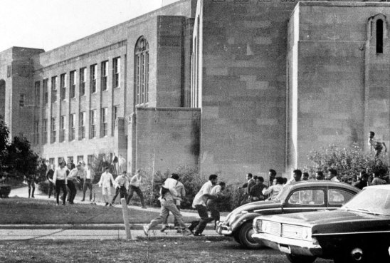 In Sept. 1969, a few months after a massive student fight in Oliver High School's cafeteria, violence once again erupted at the school, this time spilling out onto the grounds outside. (Al Herrmann Jr./The Pittsburgh Press)