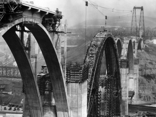 The arches take shape in 1932. (Photo Credit: Unknown)