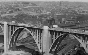 Officials estimated 30,000 people gathered along the bridge and nearby hillsides to witness the opening of the span. (The Pittsburgh Press)