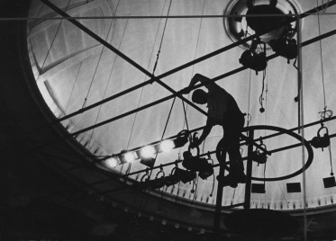 In this 1967 photo, a stagehand works with lighting in the flies above a stage at The Pittsburgh Playhouse in Oakland. (Harry Coughanour/Post-Gazette)