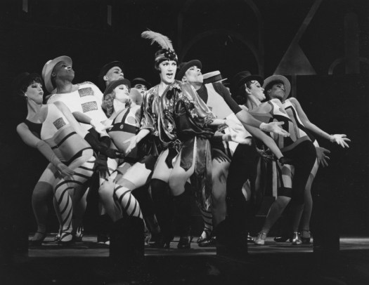 "Kathleen Marshall, center and wearing a feathered head band, starred as Velma in the 1989 Pittsburgh Playhouse production of the musical ""Chicago."""
