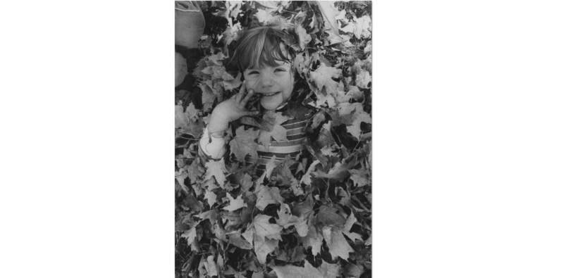 Oct. 13, 1985: Emily Szylinski, 4, of Mt. Lebanon covered with leaves near Cochran Road. (Darrell Sapp/Post-Gazette)