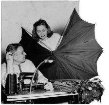 Sam Cohen in his umbrella repair shop. (Pittsburgh Press photo)