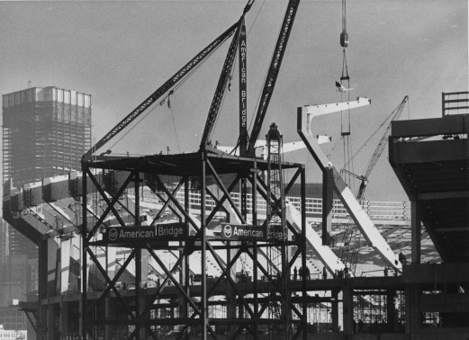 Dec. 10, 1969: As the U.S. Steel headquarters rises behind it, the final C frame is lifted into place. (Harry Coughanour/Post-Gazette)