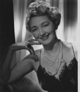 This image from 1942 shows Hedda Hopper in a slip and pearls, long after her career as a silent film actress had ended in the 1930s. (Ted Allan)