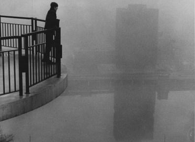 Feb. 9, 1970: Marty Molyneux, 16, of Mt. Washington peers out at the fog on the Monongahela River. (Harry Coughanour/Post-Gazette)