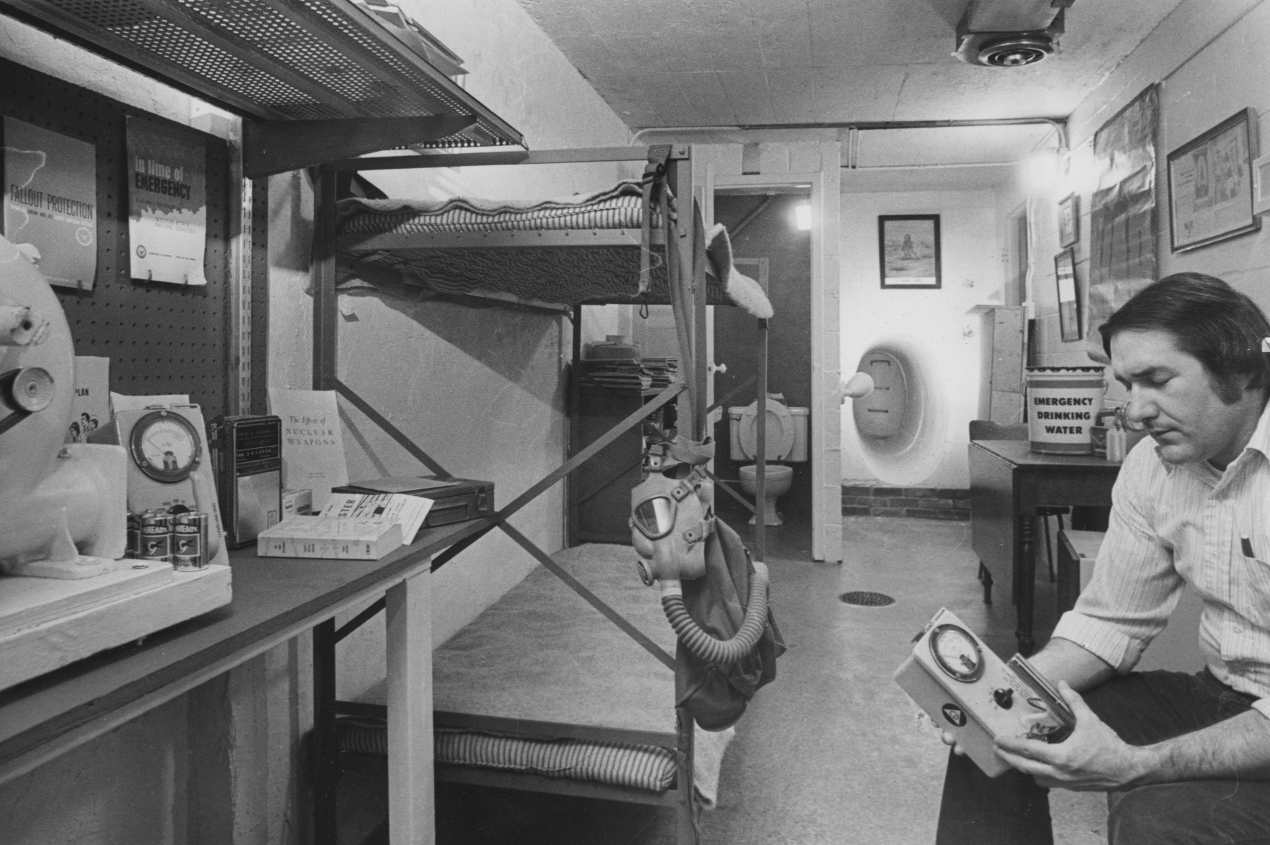 April 14, 1980: James Allan, of Pleasant Hills, double-checks a radiation detector in a fallout shelter located in the basement of his home. He would get an A plus grade in the survey being conducted by Allegheny County authorities. (Bill Levis/Post-Gazette)