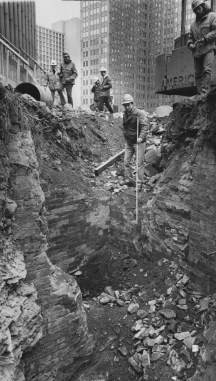 Feb. 24, 1982: Soils engineer David Druss measures the subway trench against the foundation of the old Wabash Railroad Terminal in Gateway Center. (Bill Levis/Post-Gazette)