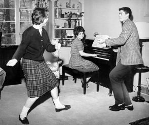 Learn the twist! That's what The Pittsburgh Press commanded in 1962. Hope Steverman and Clem English took up the challenge. Andy Gamble's at the piano. (Pittsburgh Press photo)