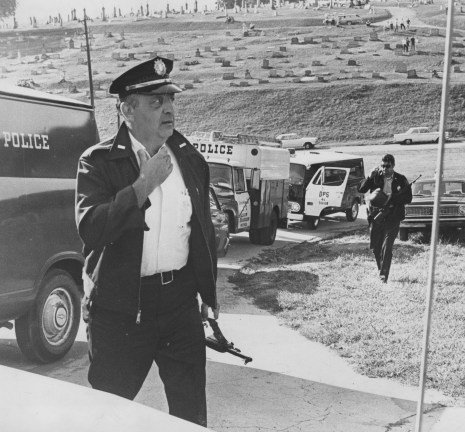 Police Lieutenant Robert Reese, foreground, and an unidentified officer search a cemetery in September 1969 after a manhunt is launched Stanley Hoss. (Howard R. Moyer/The Pittsburgh Press)