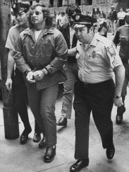 Law enforcement officers escort Stanley Hoss into the Allegheny County Courthouse in May 1977. (Post-Gazette Photo/ Bill Levis)
