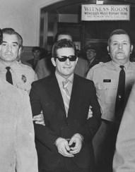 Deputy Sheriff Michael Scherbanic and Deputy Sheriff Raymond Goga escort Stanley Hoss from the Allegheny County Courthouse in March 1970. (Al Herrmann, Jr./The Pittsburgh Press)