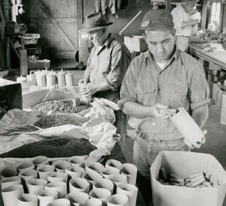 Wilbert Watson (front) and Tony Salamone stuff shells with firecrackers, fuses, and more in 1955.
