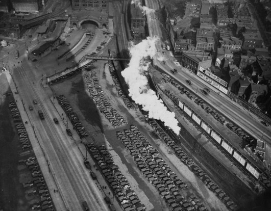 May 27, 1932: An aerial view of the parking lot near Penn Station and a train leaving the station. (The Pittsburgh Press)