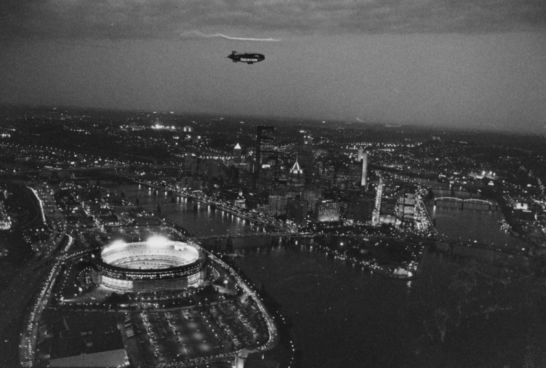 October 9, 1991: The airship Shamu, owned by Sea World, hovered at 1,000 feet above Downtown Pittsburgh just before the start of the Pirates' National League Championship Series game with the Atlanta Braves at Three Rivers Stadium. This photograph was taken from a helicopter. (J. Bruce Baumann/The Pittsburgh Press)