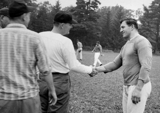 """Steelers coach Buddy Parker greets veteran and future Hall of Famer Ernie Stautner at training camp. The original caption reads, """"Parker is aloof with his players and mostly contacts them through aides."""" (Stewart Love/Post-Gazette)"""