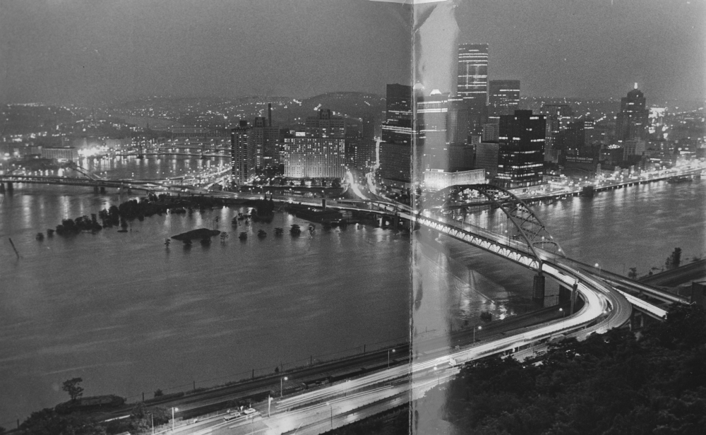 This view of Pittsburgh's Point shows water surrounding the Fort Pitt Blockhouse as the swollen Monongahela River races under the Fort Pitt Bridge. (Dale Gleason/The Pittsburgh Press)