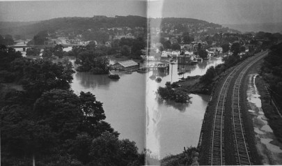 Buffalo Creek, which normally runs under the railroad tracks at the right in this picture and into the Allegheny River, was running all through Freeport when this photo was taken at 5:30 a.m. on Saturday, June 24, 1972. By then, flood waters had receded by about two feet.