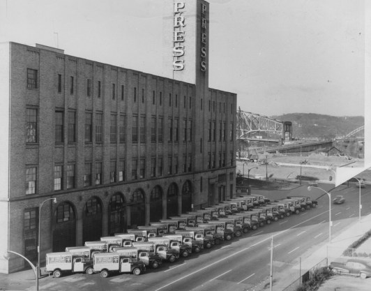 1957: An exterior view of The Pittsburgh Press office building at 34 Blvd. of the Allies. Delivery trucks are lined up on the Boulevard of the Allies.