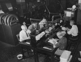 May 27, 1957: Copy readers work in the composing room of The Pittsburgh Press office.