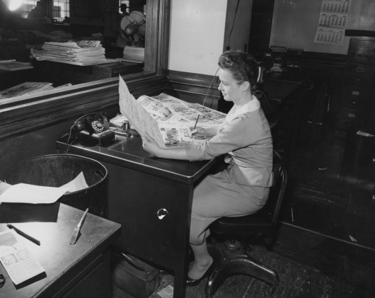 May 27, 1957: An editor proofing the copy at the Pittsburgh Press office.