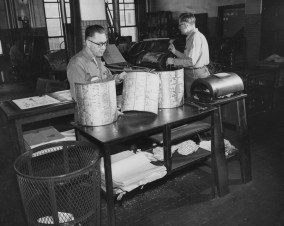 1957: Employees of The Pittsburgh Press work with color plates in the newspaper's stereotyping department.