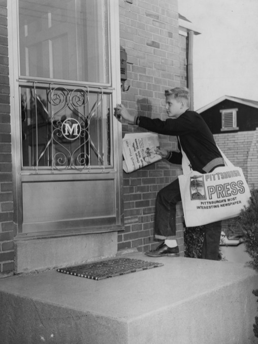 September 27, 1957: Dickie Kamerer delivers copies of The Pittsburgh Press to 4806 Glenallen Drive in Whitehall. Kamerer, 14, began delivering the paper in 1954.